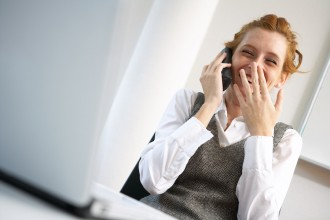 laughing businesswoman talking phone